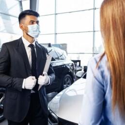 car dealer in mask